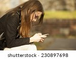 pretty girl using mobile phone... | Shutterstock . vector #230897698