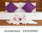 Stock photo romantic two towels on white bed sheet 231010465