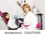 female dentist with x ray and... | Shutterstock . vector #231075505