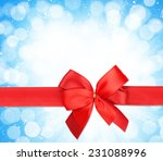 red ribbon with bow over... | Shutterstock . vector #231088996