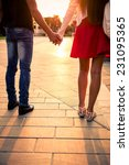 couple hand by hand at sunset....   Shutterstock . vector #231095365