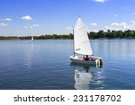 Small White Boat Sailing On Th...