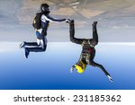 a girl and a guy skydivers... | Shutterstock . vector #231185362