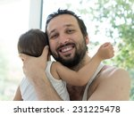 father and baby boy at home... | Shutterstock . vector #231225478