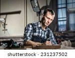 young craftsman in uniform... | Shutterstock . vector #231237502