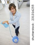 young housekeeper standing with ... | Shutterstock . vector #231316255