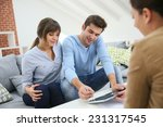 young couple signing financial...   Shutterstock . vector #231317545