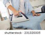 closeup of woman ironing...   Shutterstock . vector #231320335