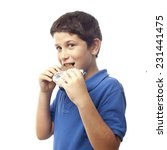 closeup of boy eating chocolate ... | Shutterstock . vector #231441475