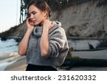 brunette on sea coast in autumn ... | Shutterstock . vector #231620332