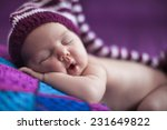 newborn baby girl smiling  | Shutterstock . vector #231649822