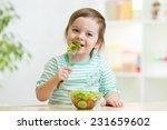 Kid Girl Eating Healthy...