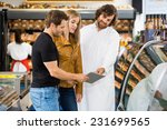 mid adult salesman and couple... | Shutterstock . vector #231699565