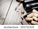 bottle of red wine and corks....