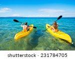 Couple Kayaking In The Ocean On ...