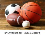 Sports balls on wooden...