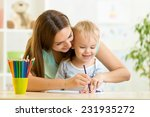 child boy and mother drawing... | Shutterstock . vector #231935272