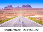 Desert highway leading into Monument Valley, Utah, USA - stock photo