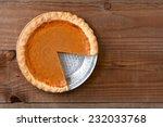 A Pumpkin Pie With A Slice Cut...