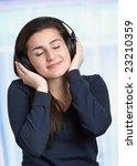 young woman enjoying listening...   Shutterstock . vector #23210359