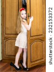 little girl in mother's shoes   Shutterstock . vector #232153372