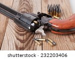 a pistol with bullets on a... | Shutterstock . vector #232203406