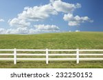 White Fence In Farm Field With...