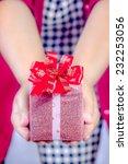 hand holding gift box for... | Shutterstock . vector #232253056