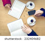 table with coffee cups e book... | Shutterstock . vector #232404682