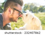 Stock photo moments of love between dog and his owner concept about pets and animals 232407862