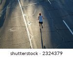 A Lone Marathon Runner Heads...