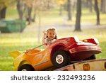 little girl riding a car in...   Shutterstock . vector #232493236