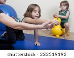 a female physiotherapist makes... | Shutterstock . vector #232519192