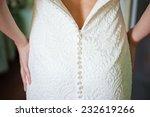 wedding dress rear detail. | Shutterstock . vector #232619266