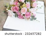 notebook with flowers | Shutterstock . vector #232657282