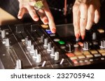 dj hands on the remote.... | Shutterstock . vector #232705942