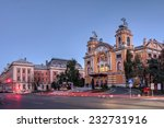 Small photo of CLUJ, ROMANIA - OCTOBER 18: Twilight in Cluj Napoca, Romania with the Lucian Blaga National Theatre and the Palace of Justice on the evening of October 18, 2014.