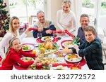 family pulling christmas... | Shutterstock . vector #232772572
