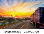 Truck Traveling On Road At...