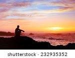 Woman Sitting Alone At Sunset...