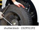 car mechanic changing tire in... | Shutterstock . vector #232951192