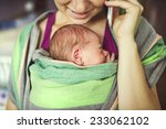 newborn baby hold by mother in... | Shutterstock . vector #233062102