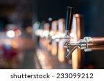 beer tap in a row | Shutterstock . vector #233099212