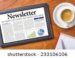 tablet on a desk   newsletter   Shutterstock . vector #233106106