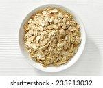 bowl of oat flakes on white... | Shutterstock . vector #233213032
