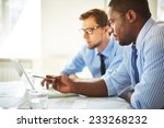 man pointing at laptop for his... | Shutterstock . vector #233268232