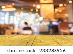 wood table and coffee shop blur ... | Shutterstock . vector #233288956