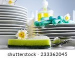 washing glasses and plates with ... | Shutterstock . vector #233362045