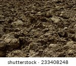 freshly ploughed field fragment | Shutterstock . vector #233408248