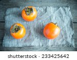 fresh persimmons on the wooden... | Shutterstock . vector #233425642